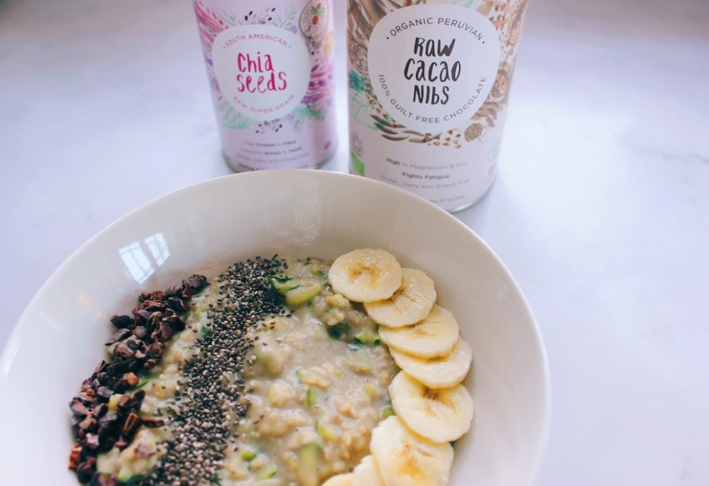 Vanilla Protein Oats Topped With Banana, Chia Seeds And Cacao Nibs